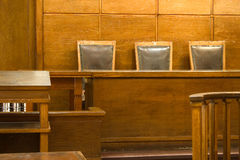 Court room. Old vintage court room. Close-up of the judges chairs stock photos