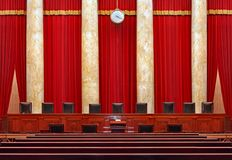 Court room interior at the United States Supreme Court. The seats for the nine powerful judges of the Supreme Court face the courtroom against a red backdrop stock photo