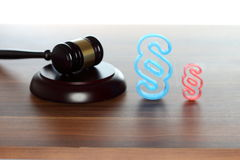 Court room symbol. With gavel and paragraph royalty free stock photos