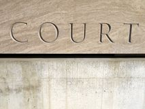 Court sign. Carved court sign in stone block Royalty Free Stock Images