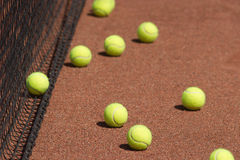 Court, tennis balls and net closeup Royalty Free Stock Images