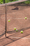 Court, tennis balls and net closeup Royalty Free Stock Photo