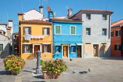 Court yard of the multi-colored Burano island in the sunny day. Venice, Italy Royalty Free Stock Images