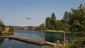 Courtenay air park. A plane flying over Courtenay River into Courtenay Air Park, Comox Valley, British Columbia, Canada Royalty Free Stock Photography