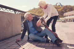Courteous senior lady helping a passer-by get up Stock Images