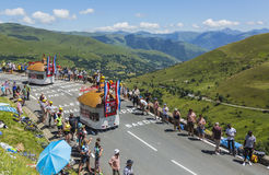 Courtepaille Restaurant Vehicles - Tour de France 2014. Col de Peyresourde,France- July 23, 2014: Courtepaille Restaurant vehicles during the passing of the royalty free stock photos