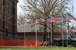 Courthouse with fence, flags, truck Royalty Free Stock Photography