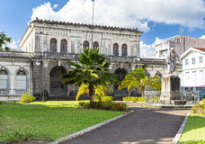 Courthouse, Palais de justice. Martinique, Fort-de-France. Martinique, Fort-de-France, Statue of A. Schoelcher in front of former Courthouse building Stock Images