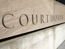 Courthouse sign. Carved courthouse sign in stone block Stock Photos