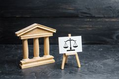 Courthouse and a sign with scales. The concept of the court and the judiciary, justice. Respect for the rights of man and citizen. The resolution of conflict stock photography