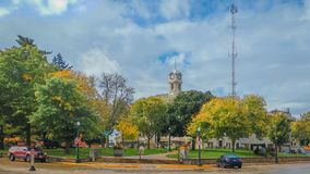 Courthouse Square Downtown Baraboo, Wisconsin. Courthouse square located in downtown Baraboo, Wisconsin. The tall clock tower is seen rising above the trees royalty free stock images