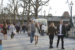 Courting couples stroll along the Southbank of the Thames in the Stock Images