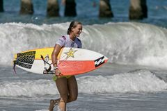 Courtney Conlogue surfing in the Vans US Open of Surfing 2018 Royalty Free Stock Image