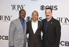 Courtney Vance, George C. Wolfe, and Tom Hanks. Actor Courtney Vance, director George C. Wolfe, and actor Tom Hanks appear at the Meet the Nominees Press Junket Stock Photography
