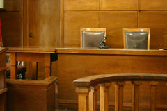 Courtroom. Classical court room with 2 chairs, wooden bench and interior royalty free stock images