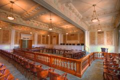 Courtroom. Arkansas Supreme Courtroom with morning light streaming through draped windows Royalty Free Stock Image