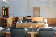 Courtroom with benches and stand. View of a courtroom with judge and lawyers bench royalty free stock image