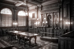 A Courtroom From the Last Century Court room. A courtroom scene from a time long ago stock photography