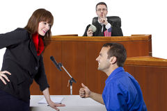 Courtroom Trial. Corrupt judge taking bribe in an unfair courtroom trial royalty free stock images