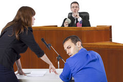 Courtroom Trial. Corrupt judge taking bribe in an unfair courtroom trial stock images
