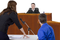 Courtroom Trial. Defendant with lawyer speaking to a judge in the courtroom