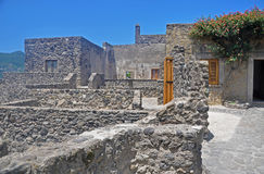 The courts of the Aragonese castle. The stone courtyards of the old Aragonese castle on blue sky background Stock Image