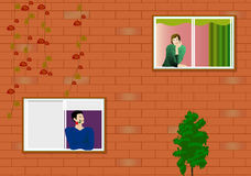 Courtship. Boy and girl in two windows Stock Image