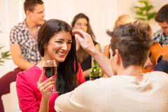 Courtship At House Party Royalty Free Stock Images