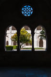Courtyard of Alcobaca Monastery seen through a window Stock Image
