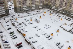 The courtyard apartment building in the winter. In the yard Parking, Playground and cars stock photography