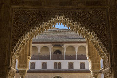 Courtyard and arch of Alhambra palace. View through the arch from inside out on one of the courtyards of amazing Alhambra palace in Andalusia, Spain Stock Images