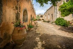 Courtyard of the Arkadi Monastery with large flower pots in Crete, Greece stock photo