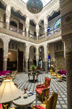 Courtyard with beautiful chairs, tables and columns in Fes Stock Images