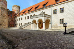 Courtyard with beautiful stairs of medieval castle in Cesis town, Latvia Royalty Free Stock Photo