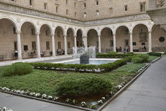 Courtyard of the Boston Library. A garden surrounds a fountain in the Boston Library courtyard. The flowers and water works are framed by archways containing Royalty Free Stock Photography