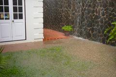 A courtyard in the caribbean being flooded during the rainy season Stock Photo