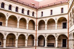 Courtyard castle arcades Pieskowa Skala. Courtyard castle arcades Pieskowa Skala , medieval building near Krakow, Poland Royalty Free Stock Images