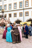 Courtyard of the castle, ladies and gentlemen in the costumes of Stock Photography