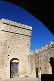 Courtyard of a castle of middle ages. A foreshortened view of the courtyard of the medieval fortress of mussomeli, sicily, a well known sample of architecture of Royalty Free Stock Photos