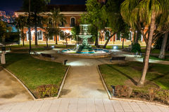 "Courtyard with the central source of the house ""Colon"" in Huelva. Night view of the courtyard with the central source of the house ""Colon"" in Stock Images"