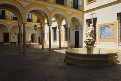 Courtyard Charity Hospital. The Charity Hospital of Seville is an architectural and artistic summit of Spanish baroque art. The Brotherhood of the Holy Charity Stock Images