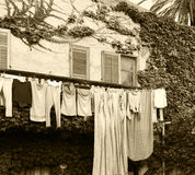 Courtyard with clothes hanging, sepia hue Royalty Free Stock Images
