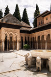 Courtyard decorated with a fountain. At the historic site of the Alhambra in spain Royalty Free Stock Photos