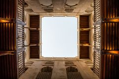 Courtyard of a desert fort shot upwards from the ground. View of a courtyard of desert fort showing balconies and sky Royalty Free Stock Photo