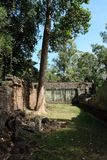 The courtyard of the dilapidated temple complex in Indochina. Ancient ruins in the forest.  stock image