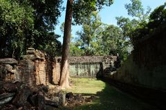The courtyard of the dilapidated temple complex in Indochina. Ancient ruins in the forest.  royalty free stock photography
