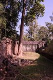 The courtyard of the dilapidated temple complex in Indochina. Ancient ruins in the forest.  royalty free stock image