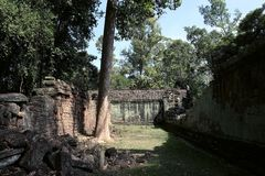 The courtyard of the dilapidated temple complex in Indochina. Ancient ruins in the forest.  stock photography
