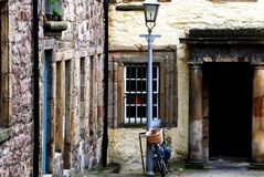 Courtyard in Edinburgh. This courtyard was photographed in Edinburgh, Scotland. This was a serene scene with soft and muted colors. The bicycle was needed to Stock Image