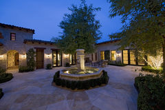 Courtyard With Fountain At Dusk Royalty Free Stock Photography